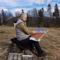 Лис Мисюга малює чергову картину Сокола